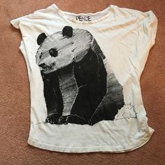Peace Generation panda t-shirt This cute little panda t-shirt is by Peace Generation. It has been worn before but is in nice condition. It is a size large and is selling for $3! Peace Generation Tops Tees - Short Sleeve