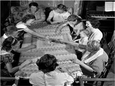 "Quilting circle - working on a classic ""trip around the world"" quilt of the 1930's or 1940's"