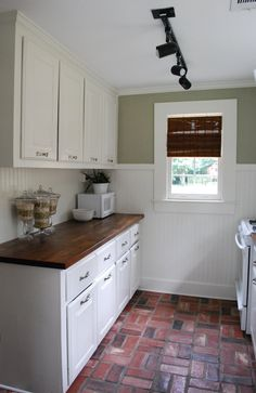 kitchen remodel on a little budget - I LOVE the brick flooring with wood counter tops!