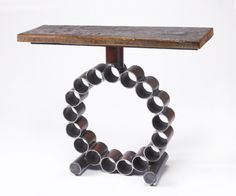 Creates metal sculptures and furniture using reclaimed farm machinery and barn wood. http://launchgrowjoy.com/gatski-metal/#