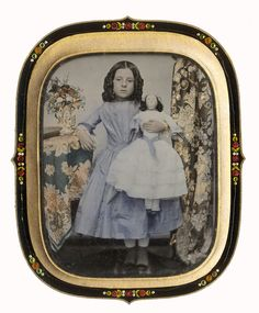 English quarter-plate ambrotype of a young girl holding her doll