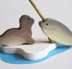 Seal and Narwal wooden toys! I'm sure that horn is a safety hazard, but it was so cute and made me think of Emi.
