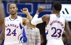 Kansas teammates Travis Releford (24) and Ben McLemore bump elbows after a bucket by McLemore ~