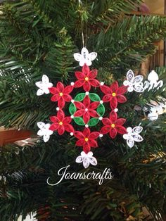 This is a variation of my 2013 design. This design with color was actually in my minds eye when I was creating the 2013 design. There is a flower in the center surrounded with a wreath. 6 poinsettias encircle the center. The size is 5 from tip to tip. This is my 2014 addition to my snowflake co