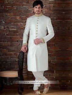 Splashed #white men's #sherwani for #wedding and #reception in #jamawar fabric. Heavy embroidered collar and sleeves, buttons detail on sherwani front http://www.needlehole.com/splashed-white-mens-sherwani-for-wedding-and-reception.html Men's #sherwani for #wedding and reception made in #jamawar. Latest #designer sherwani for men kurta shalwar | kids sherwanis and sherwani for boys at discounted sales price