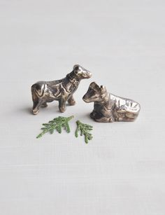Hey, I found this really awesome Etsy listing at https://www.etsy.com/listing/254082115/2-vintage-brass-cow-figurines-tiny