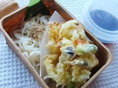 Udon and vegetable tempura (kakiage) bento. The dipping sauce is carried in the plastic container with lid.