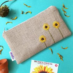 Items similar to Sunflower Burlap Clutch - Zipper Pouch - Hand Embroidered Clutch - Sunflower Wedding - Bridesmaid Gift on Etsy 20 Swoon Worthy Zipper Pouches (for when you dont want to sew your own! This zipper bag is made of tightly woven linen linen an Embroidery Bags, Embroidery Stitches, Embroidery Patterns, Purse Patterns, Sewing Patterns, Sunflower Colors, Wedding Gifts For Bridesmaids, Handmade Bags, Etsy Handmade