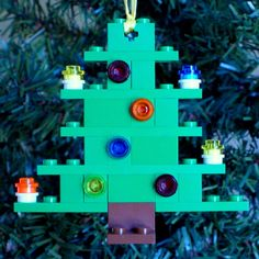 Christmas Tree Ornament made with LEGOs.  Each layer is glued so this will not come apart. All proceeds benefit children in homeless and domestic violence shelters! Sale starts in October.  www.ornaments4charity.com