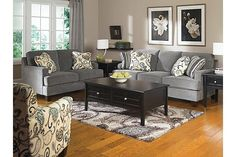 """The Yvette Sofa from Ashley Furniture HomeStore (AFHS.com). With the rich artistic beauty of the sleek set-back arms and the deep finished tapered block feet, the Metro Modern design of the """"Yvette-Steel"""" upholstery collection uses soft upholstery fabric and plush cushioning to create an exceptional addition to any living room décor."""