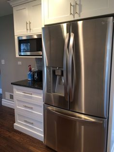 Love this LG SS fridge.  Next to it is a coffee station.  Coffee pot and toaster are on the counter.  Built-in microwave above with upper cabinets holding teas and bread spreads.  The first drawer below was made tall enough to hold coffee mugs and thermos.  Middle drawer has a bread drawer and a divider for coffee and sugar, creamer, etc.