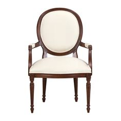 Our simplified interpretation of a late-Neoclassical French chair. Less fuss. More clarity. Comfortable for today's bodies.  Fully hand-carved.  A dining chair with presence. An accent chair with panache. An opportunity for self-expression: In any of our hundreds of fabrics, this chair will say a lot about you.
