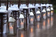 I like lanterns best when used starkly and plainly such as pictured here to line the aisle.