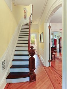 Beautiful Narrow Hallway & Staircase | via Corcoran | House & Home