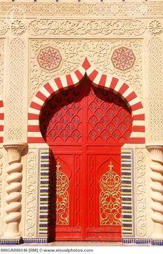 red door ~ Morocco, Marrakech, 'Chez Ali' door     ~ by Guido Alberto Rossi  www.visualphotos.com
