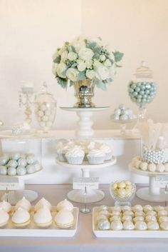 I love this all white dessert table. Great for a shower or brunch.