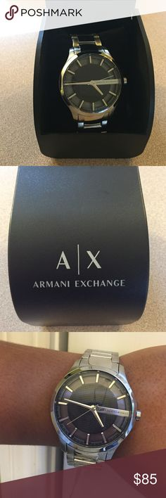 New Men's Silver A/X Armani Exchange Hampton Watch Authentic A/X Armani Exchange Polished stainless steel creates the bold sophistication of this watch. With a sleek design and textured black dial, this is a timepiece that goes with any look. The cut-through index ring shows the glass back detailing for added effect. 46-mm. case size Metal band Round dial; Japanese quartz movement Style AX2180 new with tags, all links in place, box included. Great for a men's holiday look. A/X Armani…