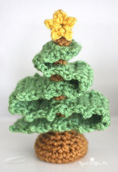 Whip up this cute mini Christmas Tree! It's a quick project that's great for holiday decor or ornaments! Get the free crochet pattern by Repeat Crafter Me and make it with Vanna's Choice (pictured in fern and honey) and a size H crochet hook. Crochet Christmas Ornaments, Christmas Crochet Patterns, Holiday Crochet, Christmas Knitting, Christmas Crafts, Ball Ornaments, Crochet Crafts, Crochet Projects, Free Crochet