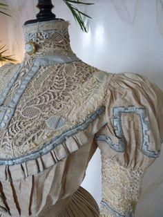 Elegant Promenade Gown, ca. 1899 Two piece beige raw silk or Dupioni silk promenade gown, ca. 1899.