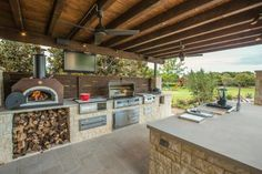 HGTV presents an outdoor entertaining area featuring a large inground pool with a nearby dining area. In addition, the space has a fully loaded gourmet kitchen.