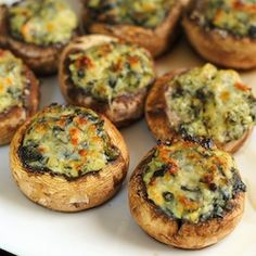 Spinach & Artichoke Stuffed Mushrooms spinach-artichoke dip  Mushrooms Sausage, browned Parm cheese clean the mushrooms, pop out their stems, mix sausage and dip and spoon into the shrooms.Sprinkle Parmesan cheese on top. Bake at 350° oven for 15 minutes (then broiled them 2 minutes to brown the tops).