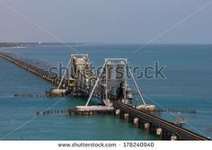 Pamban Bridge.India's first sea bridge across sea.Its a cantilever bridge.It opens up at center to make way for ships. - stock photo