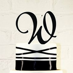"5 inch Monogram Acrylic Wedding Cake Topper Personalized in Any Letter A B C D E F G H I J K L M N O P Q R S T U V W X Y Z. Our toppers are made from acrylic and ¼"" thick with the exception of our Colored Mirrors which are 1/8"" and have a 2"" tall stake. CakeTopperMonograms also offers custom designs based on artwork you provide. If you have a custom design in mind, send it over and we can work with you to create a topper custom tailored to you! **Have A Smaller or Larger Cake?** We build..."