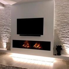 Electric Fireplace: Know the Advantages and Disadvantages Models … Living Room Decor Fireplace, Fireplace Tv Wall, Fireplace Remodel, Modern Fireplace, Living Room Tv, Deco Tv, Contemporary Fireplace Designs, Tv Wall Decor, Tv Wall Design