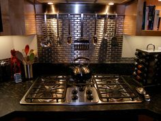 Kitchen - stainless steel tile backsplash (behind the stove only).