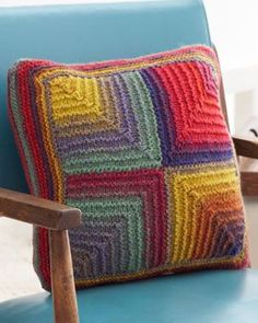 Brighten up your living space with this bright and cheerful mitered square pillow. Knit in Bernat Mosaic.
