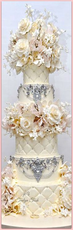 Gorgeous Ivory Wedding Cake with Rhinstones and Gold touches