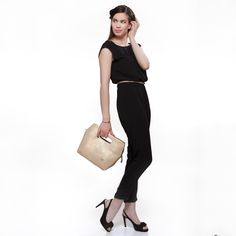 Uplift your festive mood and look wearing a black jumpsuit, a #Baggit belt cinching your waist, peep-toe shoes, and a gold inset handle #clutch to add the right amount of oomph. Look your best with this #clutch available at any Exclusive Baggit stores or www.baggit.com.