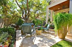 Styles and Tips for Al Fresco Dining. outdoor dining, landscape design, retaining wall, tall planters, fern, patio, shade
