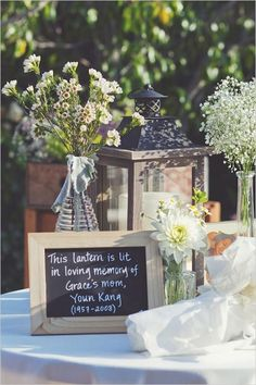 Lantern with chalkboard sign used on rustic themed wedding memory table to remember deceased loved ones.