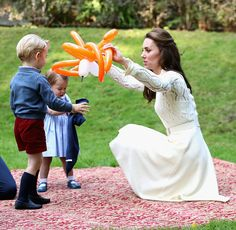 Catherine Duchess of Cambridge and Princess Charlotte of Cambridge and Prince George of Cambridge at a children's party for Military families during...