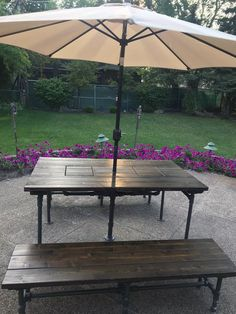 Outdoor patio table with built-in hidden coolers, umbrella holder and industrial pipe legs - Patio Table, Outdoor Tables, Outdoor Umbrella, Table Umbrella, Rustic Outdoor, Outdoor Decor, Umbrella Holder, Under The Table, Dark Walnut Stain