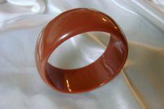 https://www.etsy.com/listing/248695481/wide-dark-caramel-brown-lucite-bangle