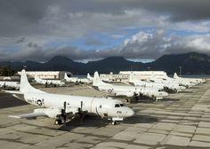 A flight line full of Lockheed P-3C Orions