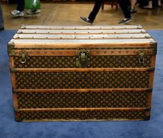 This Louis Vuitton steamer trunk, ca. 1915, saw global travels with its wealthy owners. Today many people repurpose trunks like this for artful home decor.
