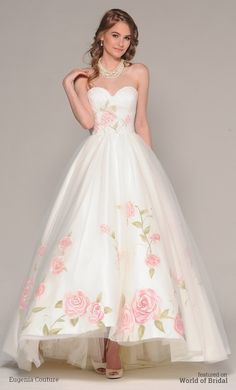 Full satin high low with delicate, hand painted roses over skirt and bodice, soft gathered tulle over skirt and bodice. Oversized hand painted bow at back neckline is detachable.