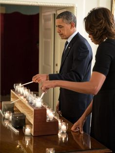 President Barack Obama and First Lady Michelle Obama Light Candles in Remembrance of the Newtown Shooting Victims