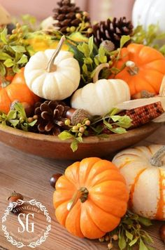 DIY Fall centerpiece - wooden bowl filled with pumpkins, pinecones and greenery. Diy Thanksgiving Centerpieces, Thanksgiving Table, Thanksgiving Projects, Christmas Tables, Autumn Centerpieces, Holiday Tables, Fall Home Decor, Autumn Home, Fall Arrangements