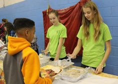 Volunteers from Youth Council helped serve hot meals to our kids!