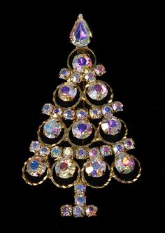 Vintage 60's Aurora Borealis Rhinestone Christmas Tree Pin [find many different styles of Christmas tree pins or brooches on ETSY or EBAY. great for your winter coat. jh]