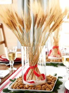 CHRISTMAS CENTERPIECE, COULD BE TRANSITIONAL USING A FALL COLORED RIBBON INSTEAD FOR FALL OR THANKSGIVING DECOR.