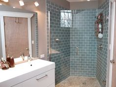 Frosted Glass Subway tile, ikea vanity, river stone shower floor we installed in our master bathroom.  Clean Slate: Before and After... (Sigh)