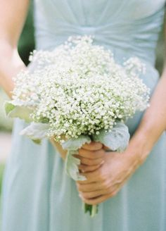 Mint green bridesmaids dress with white babybreath bridesmaids bouquet