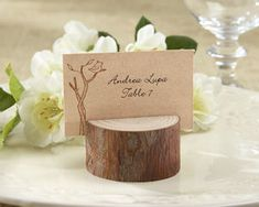 Rustic Real-Wood Place Card & Photo Holder (Set of 4) (Kate Aspen 22025NA) | Buy at Wedding Favors Unlimited (http://www.weddingfavorsunlimited.com/rustic_real-wood_place_card_photo_holder_set_of_4.html).