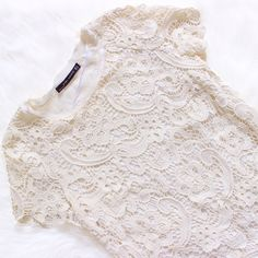 """Zara • White Crochet Lace Top Off white lace top, comes with a liner. Barely worn! Size medium but I'm a small and it fits me perfectly. Has """"sample"""" stamped on the inside of the linen but I'm not sure what it's from, that's how I bought it.   ❌No trades ❌No PayPal ❌No asking for the lowest price Zara Tops Blouses"""