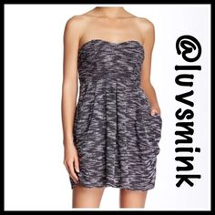 FREE PEOPLE MINI DRESS - NWT Super soft knit mini dress with side pockets, raw hem detailing, and hidden side zipper. Strapless bodice with boning, and support.  Length is approximately 28 inches; stretch to fit style. Fabric is 95% Cotton/ 5% Spandex. Color is Black/Ivory Combo.  Size 10.  Belt and leggings not included; please overlook my shower stall. I'm wearing a size 12 for comparison. No trades or holds; price is firm, unless bundled. NWT Free People Dresses Mini